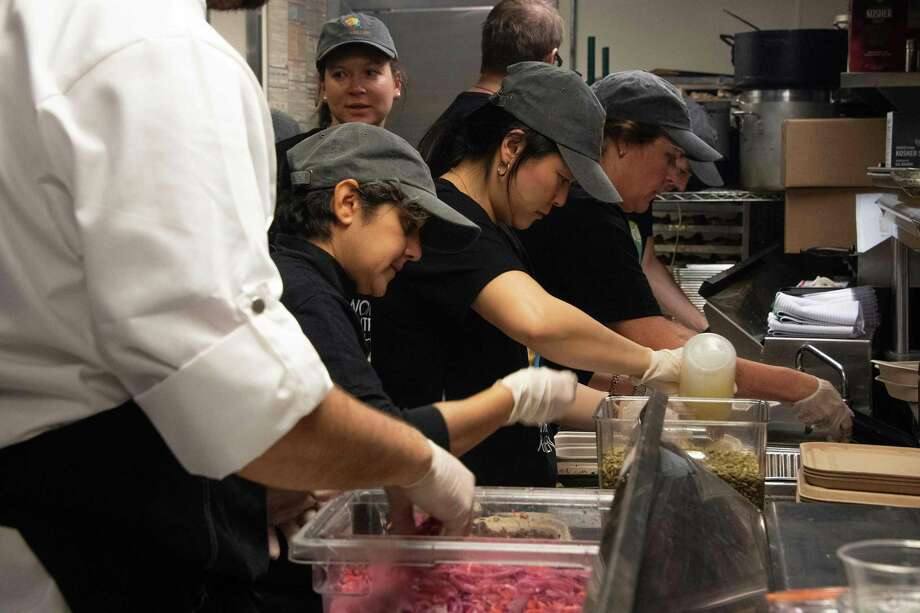 Volunteers prepare a free meal for furloughed federal workers at Andres in Washington, D.C., on Wednesday. The GOP, architects of this shutdown, used to decry people taking such handouts — but now force it. Photo: JIM WATSON /AFP /Getty Images / AFP or licensors