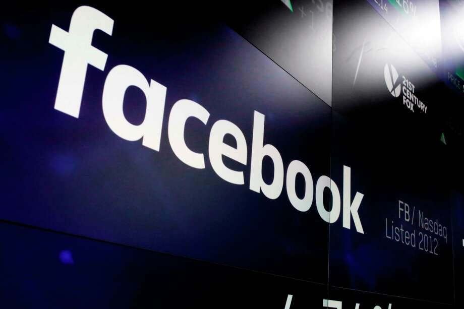FILE- In this March 29, 2018, file photo, the logo for Facebook appears on screens at the Nasdaq MarketSite in New York's Times Square. Facebook is reportedly negotiation a record fine with federal regulators. Photo: Richard Drew / Copyright 2019 The Associated Press. All rights reserved.