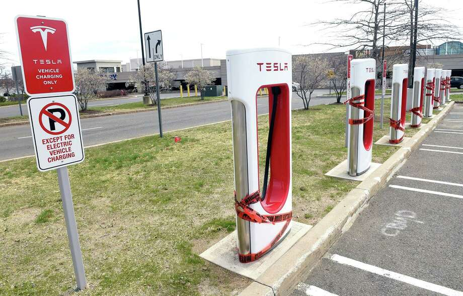 Tesla chargers have been installed in the parking lot of the Connecticut Post Mall in Milford in April 2017. Photo: Hearst Connecticut Media File