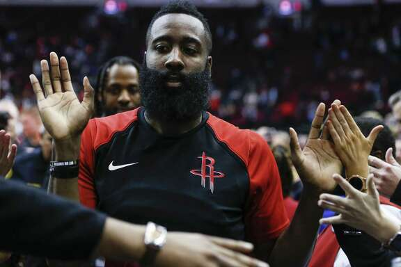 Houston Rockets guard James Harden high fives fans as he leaves the court after the Rockets 112-94 win over the Memphis Grizzlies during the second half of an NBA basketball game at Toyota Center on Monday, Jan. 14, 2019, in Houston.