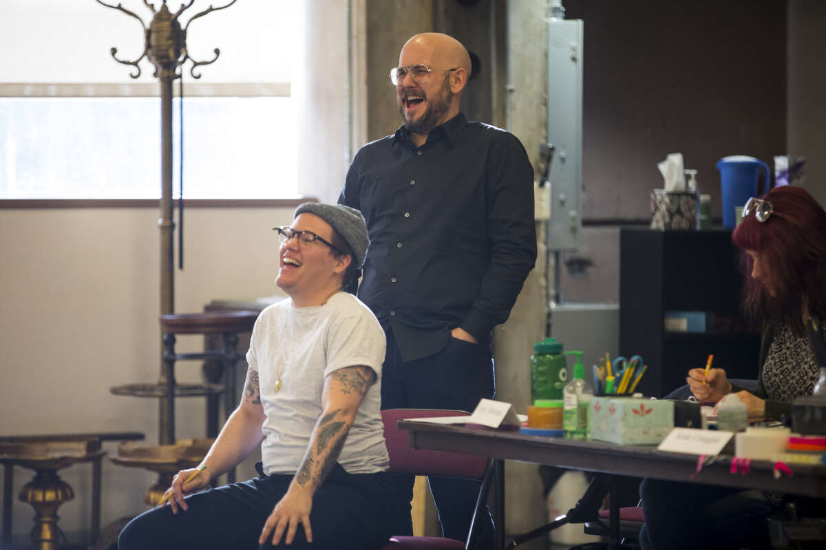 Director Will Davis laughs with writer Rob Askins during rehearsal for Askins's new play