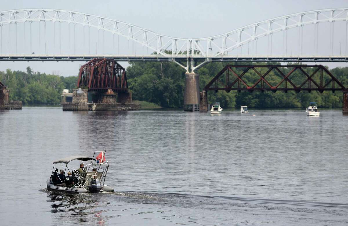 Authorities search the Connecticut River near the Arrigoni Bridge for a missing child July 6, 2015, in Middletown. Police issued an alert for 7-month-old Aaden Moreno, who may have been with his father when the man jumped from the Arrigoni Bridge.