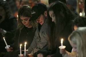 Friends and family gather during a vigil for Nichol Olsen and her two children at the Oblate Mission Lourdes Grotto on Wednesday, Jan. 16, 2019. The candlelight vigil honored Olsen, 37, and her two daughters, Alexa Denice Montez, 16, and London Sophia Bribiescas, 10, who were found shot to death at a home near Leon Springs last week.