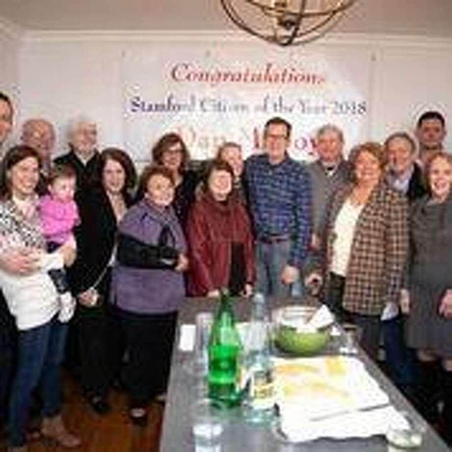 Former Gov. Dannel Malloy poses with family and friends moments after arriving at the home of his son to learn he has been chosen as the Stamford Citizen of the Year. Photo: Contributed Photo