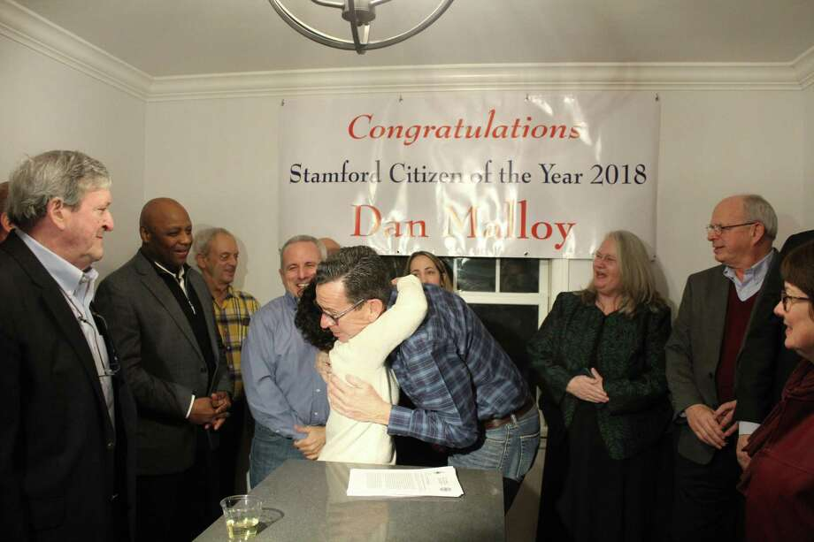 Dannel Malloy was surprised with a Citizen of the Year award in his son's home in Stamford on Thursday, Jan. 17. Malloy, a Stamford native, is the former governor of Connecticut and former mayor of Stamford. Photo: Ignacio Laguarda / Hearst Connecticut Media / Stamford Advocate
