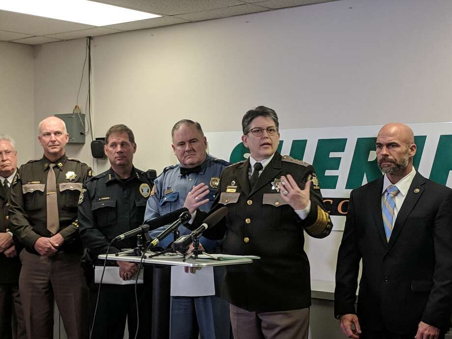 King County Sheriff Mitzi Johanknecht, along with State Patrol Capt. Ron Mead, to the left, asked the public's help in solving a spate of shootings along state Route 509 since June 2018. They are investigating at least 11 shootings in the area, but do not know whether they're related. One shooting blinded a 14-year-old boy riding in a car Dec. 20, 2018. Photo: Lynsi Burton/SeattlePI