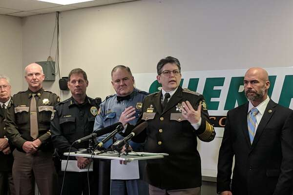 King County Sheriff Mitzi Johanknecht, along with State Patrol Capt. Ron Mead, to the left, asked the public's help in solving a spate of shootings along state Route 509 since June 2018. They are investigating at least 11 shootings in the area, but do not know whether they're related. One shooting blinded a 14-year-old boy riding in a car Dec. 20, 2018.