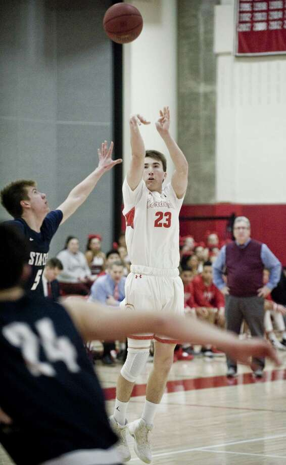 Greenwich's William Nail releases a shot against Staples on Thursday night at Greenwich High. Photo: Scott Mullin / For Hearst Connecticut Media / The News-Times Freelance
