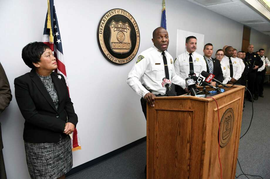 New Haven Mayor Toni Harp, left, listens to New Haven Police Chief Anthony Campbell, second from left, talk about crime statistics for 2018 during a news  conference at the New Haven Police Department Thursday. Photo: Arnold Gold / Hearst Connecticut Media / New Haven Register