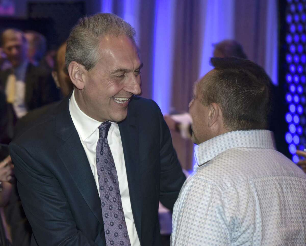 Democrat Chris Setaro greets Peter Tragni, of Waterbury, during his official campaign kick off event to announce his run for Danbury's mayor. Thursday, January 17, 2019, at the Amber Room Colonnade, Danbury, Conn.