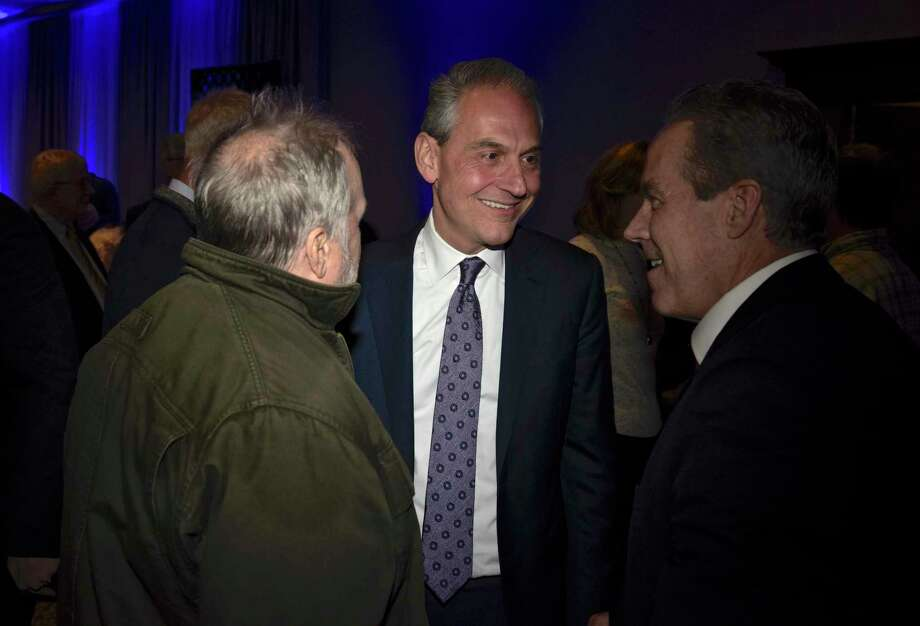 Democrat Chris Setaro, center, talks with supporters Jim Cella, of Danbury, left, and his brother Tom Cella, of Manchester, at his official campaign kick off event to announce his run for Danbury's mayor. Thursday, January 17, 2019, at the Amber Room Colonnade, Danbury, Conn. Photo: H John Voorhees III / Hearst Connecticut Media / The News-Times