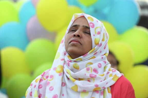 Wigdan Ahmed Mohammed, mother of Mohammed Ali Abdallah, reflects after thanking members of Gulfton community as they assembled to honor him Thursday, Jan. 17, 2019, in Houston. Abdallah, a young boy, was struck and killed by a motor vehicle as he walked with his parents and siblings in the intersection crosswalk on the way to school.