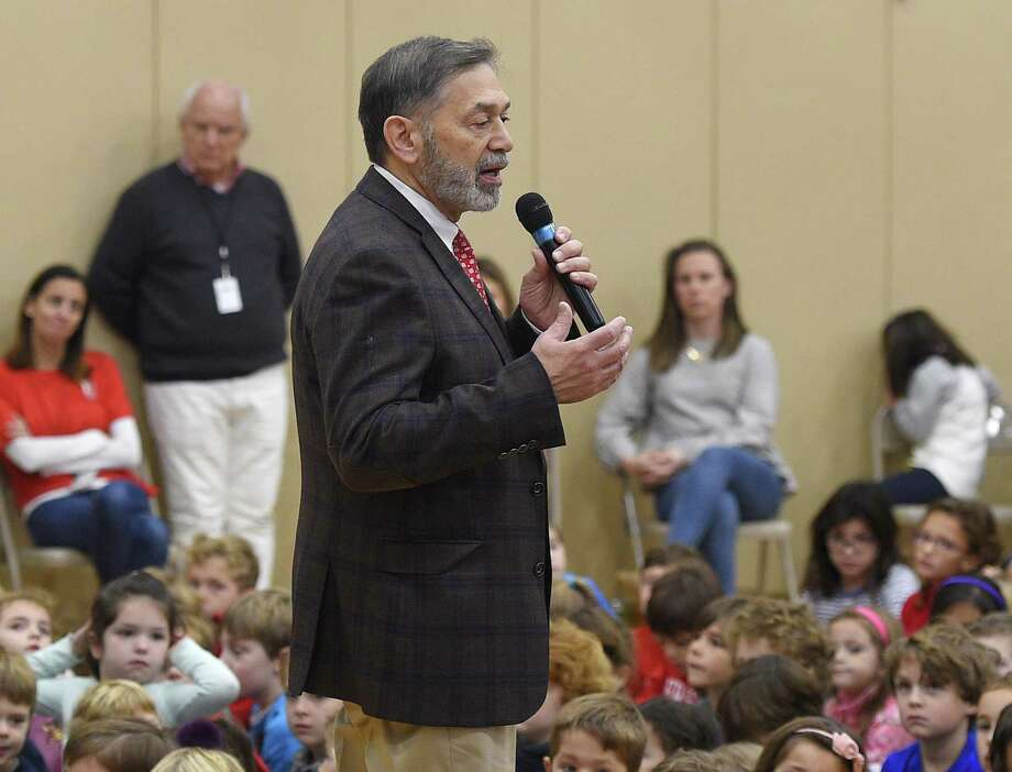 Interim Superintendent of Schools Ralph Mayo speaks at the Veterans Day ceremony at Riverside School in the Riverside section of Greenwich, Conn. Friday, Nov. 9, 2018. The ceremony featured a slideshow and musical performances to honor veterans, including the late Nick Mecca, a longtime Riverside resident and school crossing guard. Photo: Tyler Sizemore / Hearst Connecticut Media / Greenwich Time