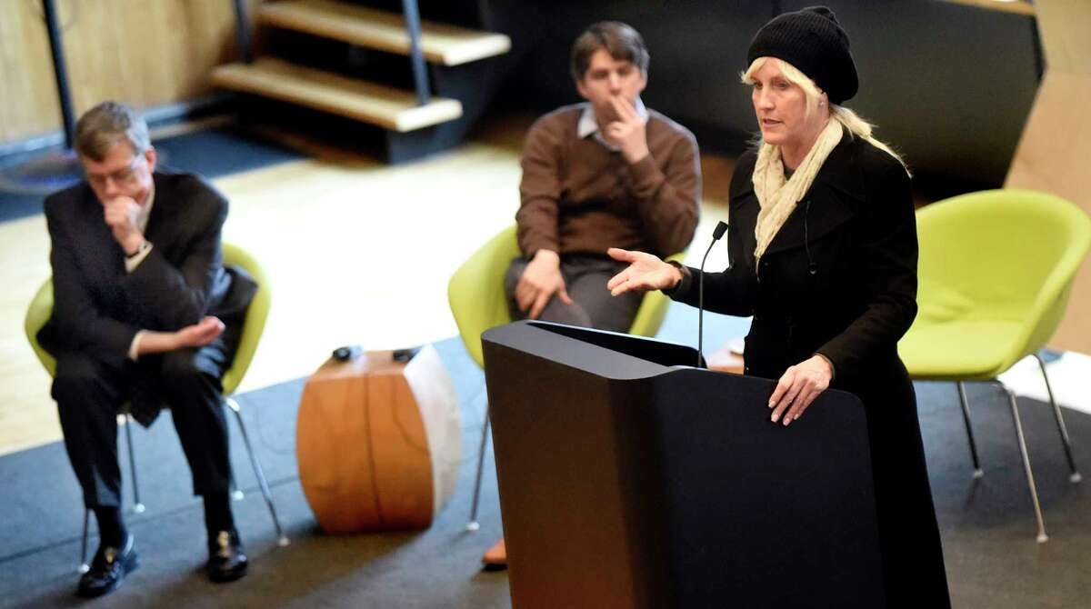 Environmental activist Erin Brockovich, right, is joined by attorneys William Walsh, left, and James Bilsborrow, both of Weitz & Luxenberg during a community meeting addressing the PFOA groundwater contamination in the village and wells in the Town of Hoosick on Saturday, Jan. 30, 2016, at Bennington College in Bennington, Vt. (Cindy Schultz / Times Union)