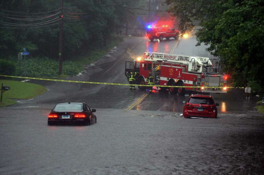 Flooding along Park Ave during a severe rainstorm in Bridgeport, Conn., on Tuesday Sept. 25, 2018. Dozens of cars were left stranded in flooded streets around the city and there have been reports of boat rescues from homes inundated by storm water as well. Photo: Christian Abraham / Hearst Connecticut Media / Connecticut Post