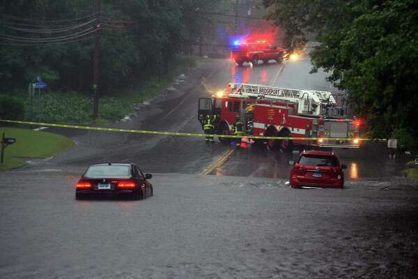 Flooding along Park Ave during a severe rainstorm in Bridgeport, Conn., on Tuesday Sept. 25, 2018. Dozens of cars were left stranded in flooded streets around the city and there have been reports of boat rescues from homes inundated by storm water as well.