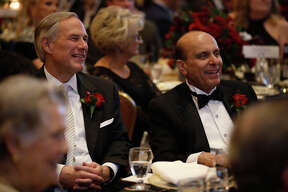Texas Governor Greg Abbott shares a laugh with S. Javaid Anwar during the Permian Basin Petroleum Association's Top Hand award banquet honoring Anwar, Jan. 17, 2018, at the Petroleum Club. James Durbin/Reporter-Telegram
