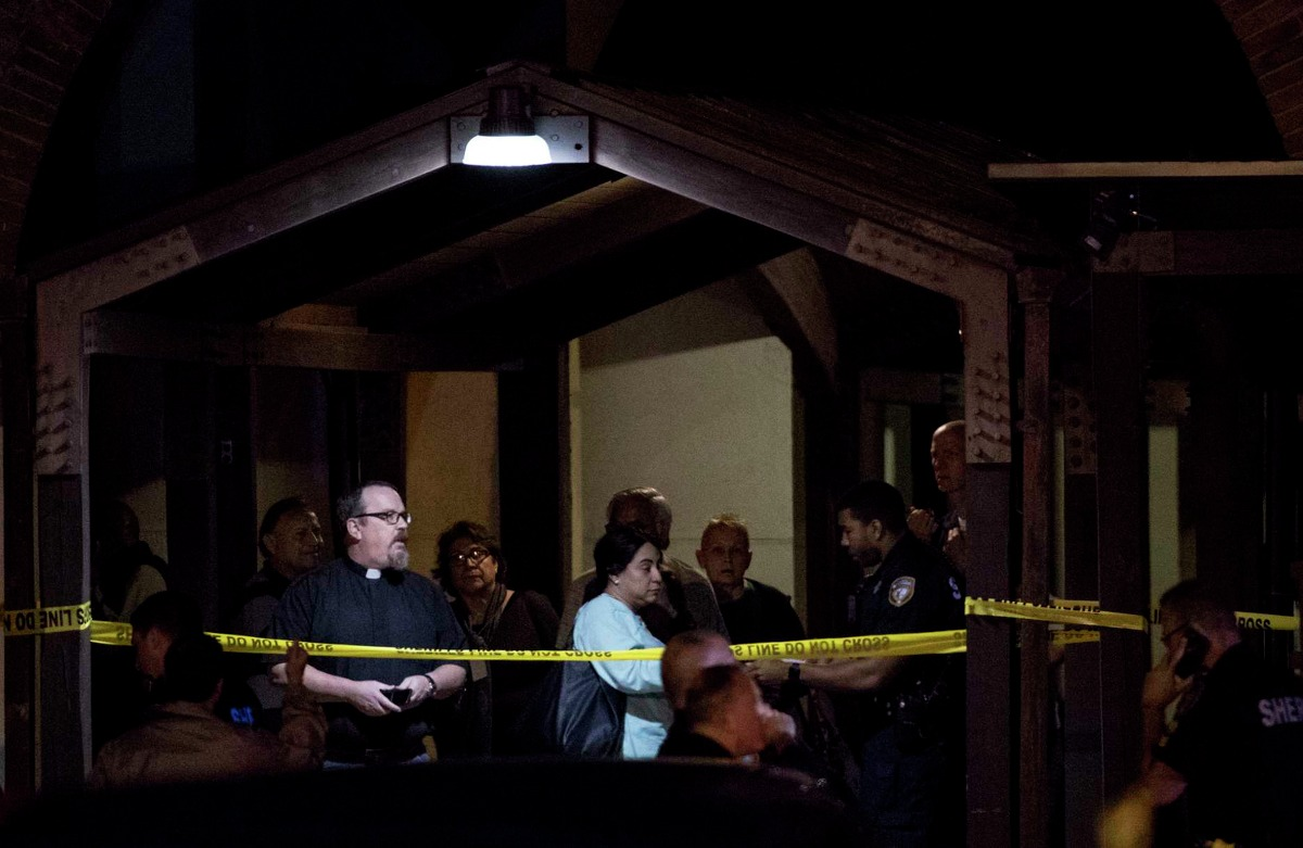 Pastor Sean Horrigan watches as Sheriff's officers investigate the scene of a shooting at Christ the Redeemer Catholic Church on Thursday, Jan. 17, 2019, in Cypress. A woman has been killed and another critically wounded as a result of the shooting that happened in a parking lot of the church in the 11500 block of Huffmeister Road, Harris County Sheriff's officials said.