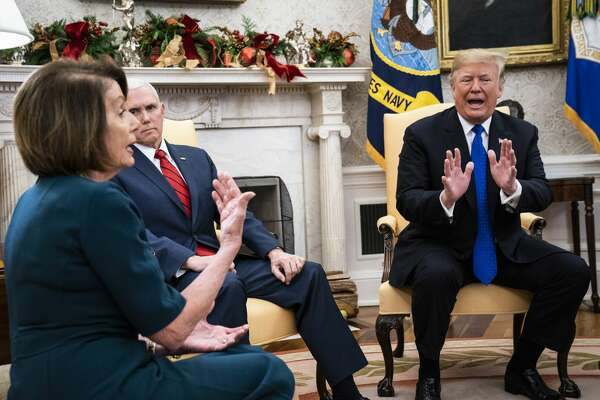 WASHINGTON, DC - DECEMBER 11 : President Donald J. Trump debates with House Minority Leader Nancy Pelosi, D-Calif., left, as Senate Minority Leader Chuck Schumer, D-N.Y., and Vice President Mike Pence listen during a meeting in the Oval Office of White House on Tuesday, Dec. 11, 2018 in Washington, DC. (Photo by Jabin Botsford/The Washington Post via Getty Images)