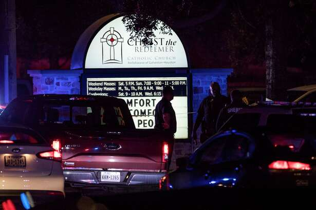 Sheriff's officers investigate the scene of a shooting at Christ the Redeemer Catholic Church on Thursday, Jan. 17, 2019, in Cypress. A woman has been killed and another critically wounded as a result of the shooting that happened in a parking lot of the church in the 11500 block of Huffmeister Road, Harris County Sheriff's officials said.