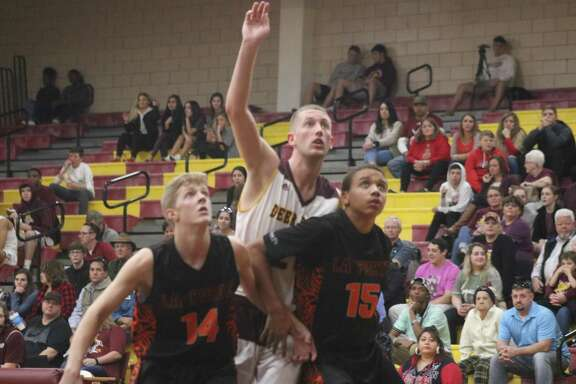 Brad Milliorn, shown fighting for better position in the paint against the Bulldogs, will take on Beaumont United Friday night at Cotton Watkins Gym. The team will be going for the first-round sweep of the Beaumont schools after downing West Brook 64-51 Tuesday.