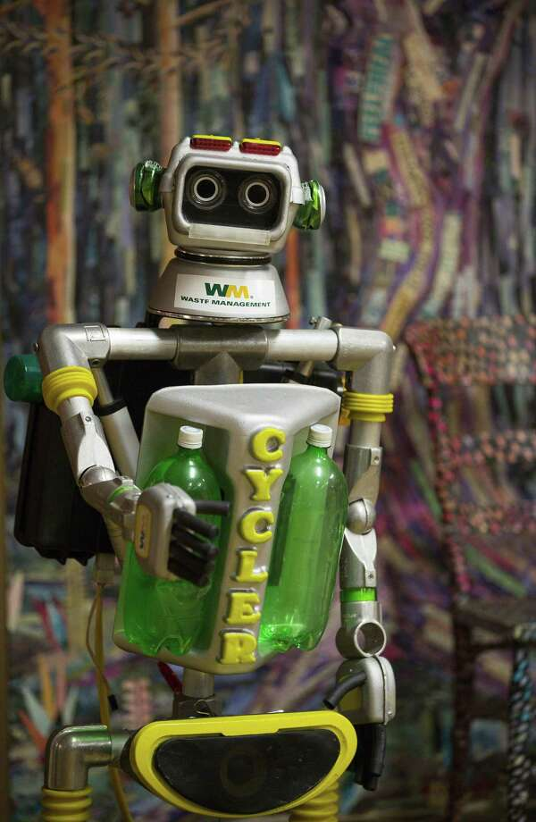 This photo taken Nov. 19, 2018, shows a motorized robot made from recycled materials stands in an education room filled with art made from recycled materials at Waste Management's facility on Gasmer Drive in southwest Houston. ( Mark Mulligan /Houston Chronicle via AP) Photo: Mark Mulligan, MBO / Associated Press / © 2018 Mark Mulligan / Houston Chronicle