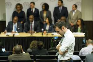 Alec Karakatsanis, who led a class action lawsuit against the county on behalf of indigent defendants challenging the county's cash bond system, listens to a press conference regarding new bail reforms for the county at Texas Southern University in Houston, Thursday, Jan. 17, 2019. The new rule allows qualifying misdemeanor arrestees to be released on a personal bond rather than a cash bond.