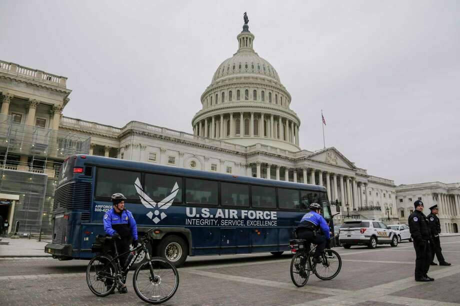 An Air Force bus waits on the plaza of the Capitol after President Donald Trump used his executive power to deny military aircraft to House Speaker Nancy Pelosi just before she was depart to visit troops abroad, on Capitol Hill in Washington, Thursday, Jan. 17, 2019.(AP Photo/J. Scott Applewhite) Photo: J. Scott Applewhite / Copyright 2019 The Associated Press. All rights reserved.