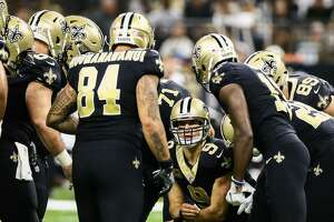 NEW ORLEANS, LA. - SEPTEMBER 17: New Orleans Saints quarterback Drew Brees (9) calls the play in the huddle during the game between between the New England Patriots and the New Orleans Saints on September 17, 2017 at the Mercedes-Benz Superdome in New Orleans, LA. New England Patriots won 36-20. (Photo by Stephen Lew/Icon Sportswire via Getty Images)