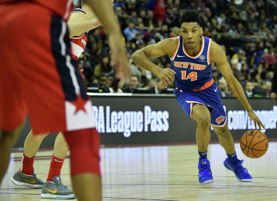 New York Knicks' Allonzo Trier (R) dribbles the ball during the NBA London Game 2019 basketball game between Washington Wizards and New York Knicks at the O2 Arena in London on January 17, 2019. (Photo by Glyn KIRK / AFP)GLYN KIRK/AFP/Getty Images Photo: GLYN KIRK / AFP