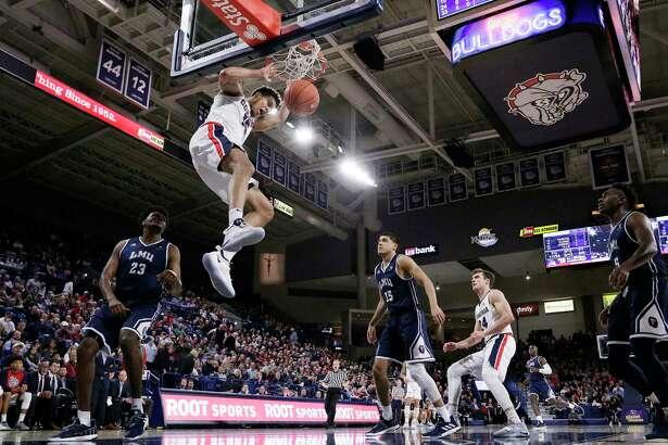 Gonzaga forward Brandon Clarke dunks during the second half of the team's NCAA college basketball game against Loyola Marymount in Spokane, Wash., Thursday, Jan. 17, 2019. Gonzaga won 73-55. (AP Photo/Young Kwak)