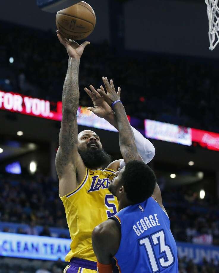 Lakers center Tyson Chandler (5) shoots over OKC's Paul George. Photo: Sue Ogrocki / Associated Press