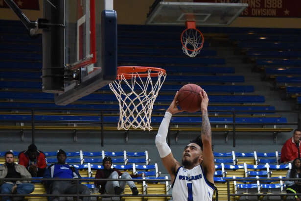 Wayland Baptist sophomore guard Tre Fillmore goes airborne for a fast break dunk against Bacone College during Thursday's Sooner Athletic Conference men's basketball game at Hutcherson Center in Plainview. The Pioneers won, 90-77.