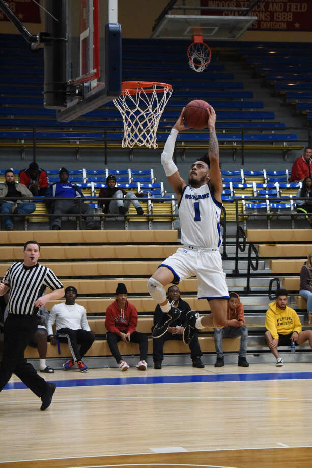 Wayland Baptist sophomore guard Tre Fillmore goes airborne for a fast break dunk against Bacone College during Thursday's Sooner Athletic Conference men's basketball game at Hutcherson Center in Plainview. The Pioneers won, 90-77. Photo: Claudia Lusk/Wayland Baptist University