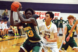 Metro-East Lutheran freshman DeMarcus Bean, left, looks to pass the ball while being guarded by Civic Memorial's Brady Meier during the first quarter of Thursday's fifth-place semifinal in the Rick McGraw Memorial Invitational at Litchfield High School.