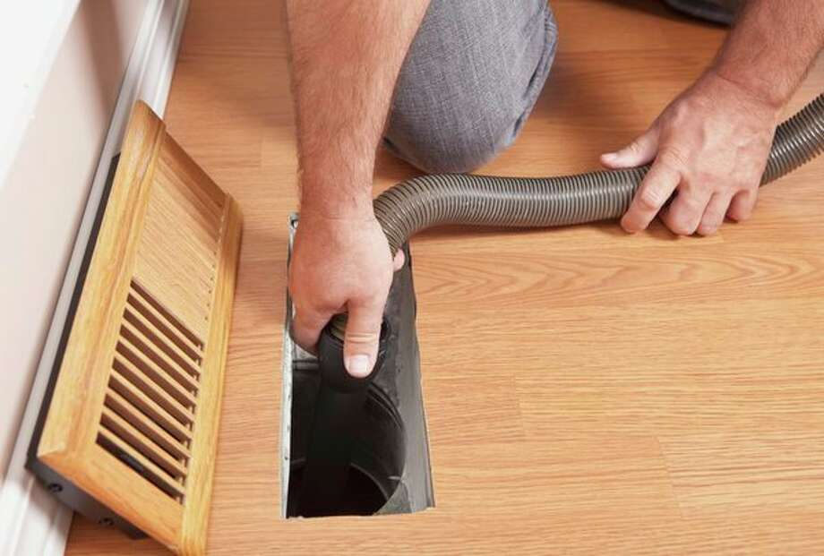 Clean vents and registers. Things can get stuck in and even build up in your home's vents and registers. Wipe down vent covers and vacuum out the register to help remove dirt and debris. (Metro Graphics) / (c) Agnieszka Szymczak