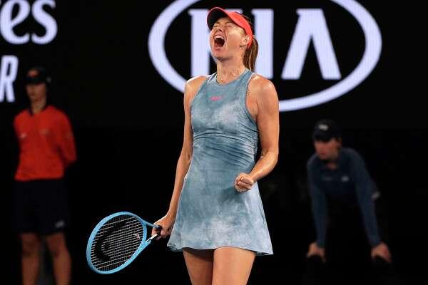 Russia's Maria Sharapova celebrates a point win over Denmark's Caroline Wozniacki during their third round match at the Australian Open tennis championships in Melbourne, Australia, Friday, Jan. 18, 2019.