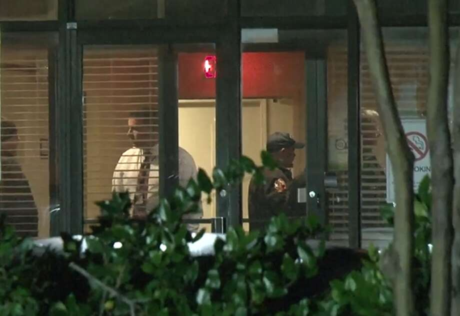 Deputies are at a standoff at a west Houston hotel Friday with a man accused of killing his estranged wife and critically wounding her daughter at Christ the Redeemer Catholic Church in Cypress on Thursday. Photo: Metro Video