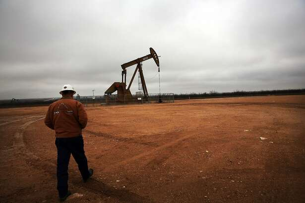 GARDEN CITY, TX - FEBRUARY 05: An oil well owned an operated by Apache Corporation in the Permian Basin are viewed on February 5, 2015 in Garden City, Texas. The well produces about 55-70 barrels of oil per day. As crude oil prices have fallen nearly 60 percent globally, many American communities that became dependent on oil revenue are preparing for hard times. Texas, which benefited from hydraulic fracturing and the shale drilling revolution, tripled its production of oil in the last five years. The Texan economy saw hundreds of billions of dollars come into the state before the global plunge in prices. Across the state drilling budgets are being slashed and companies are notifying workers of upcoming layoffs. According to federal labor statistics, around 300,000 people work in the Texas oil and gas industry, 50 percent more than four years ago. (Photo by Spencer Platt/Getty Images)