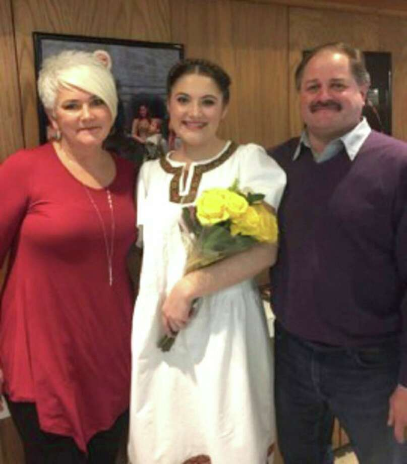 Danielle Maurer, center, is pictured with her parents, Leslie and Don Maurer. (Submitted Photo)
