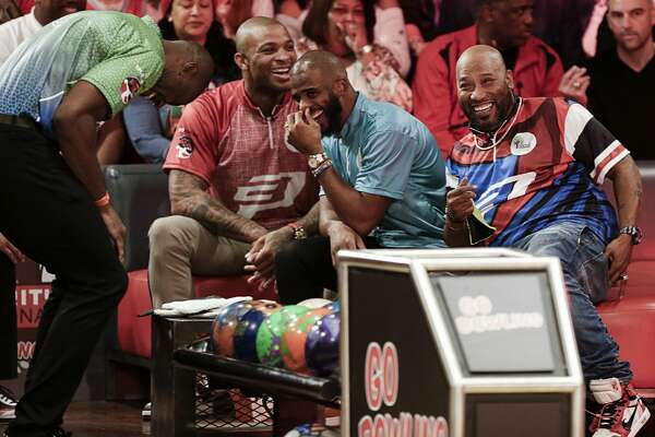 HOUSTON, TEXAS - JANUARY 17: (L-R) PJ Tucker, Chris Paul and Bun B take a selfie during the 2019 State Farm Chris Paul PBA Celebrity Invitational on January 17, 2019 in Houston, Texas. (Photo by Bob Levey/Getty Images for PBA)