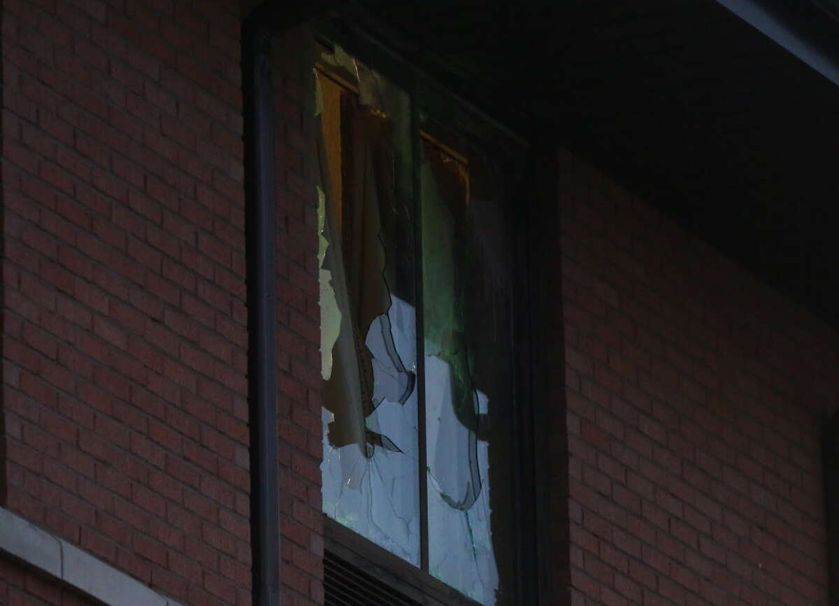 HCSO SWAT team broke the hotel window of Christ the Redeemer Catholic Church shooting suspect Arthur Edigin, 62, at the Extended Stay America on West Sam Houston Parkway South earlier on Friday, Jan. 18, 2019, in Houston. HCSO officers located the suspect at the third floor of the hotel early morning and he was found dead in the hotel bathroom with a self-inflicted wound shortly before 7 a.m.