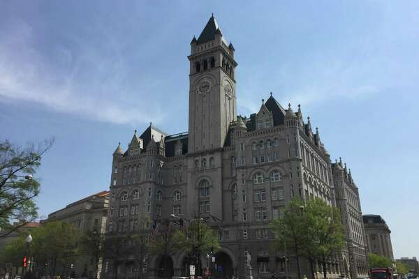 In this April 13, 2017, file photo, shows the Trump International Hotel in Washington. The inspector general for the General Services Administration says the agency improperly ignored the U.S. Constitutions emoluments provision outlawing foreign gifts when it approved President Donald Trump's management of his Washington hotel soon after his 2016 election.