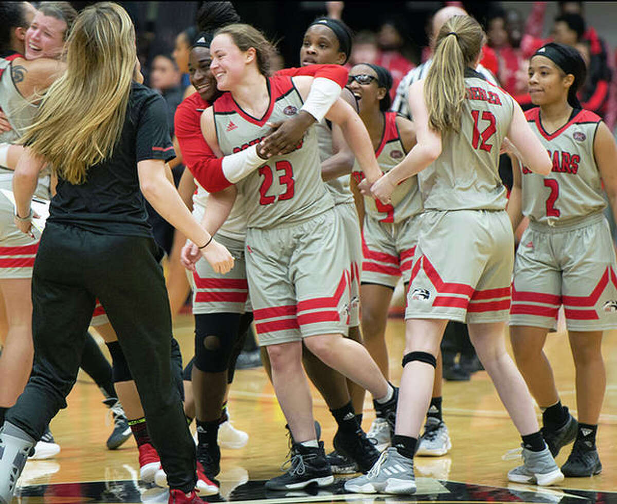 SIUE's Allie Troeckler (23) and her teammates celebrates her game-winning shot in Thursday night's 69-68 Cougars victory over Austin Peay at the Vadalabene Center.