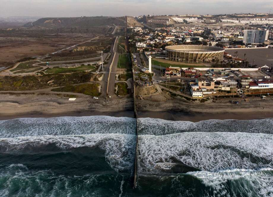 Aerial view of the US-Mexico border fence seen from Playas de Tijuana, Baja California state, on January 11, 2019. Photo: GUILLERMO ARIAS/AFP/Getty Images, Getty
