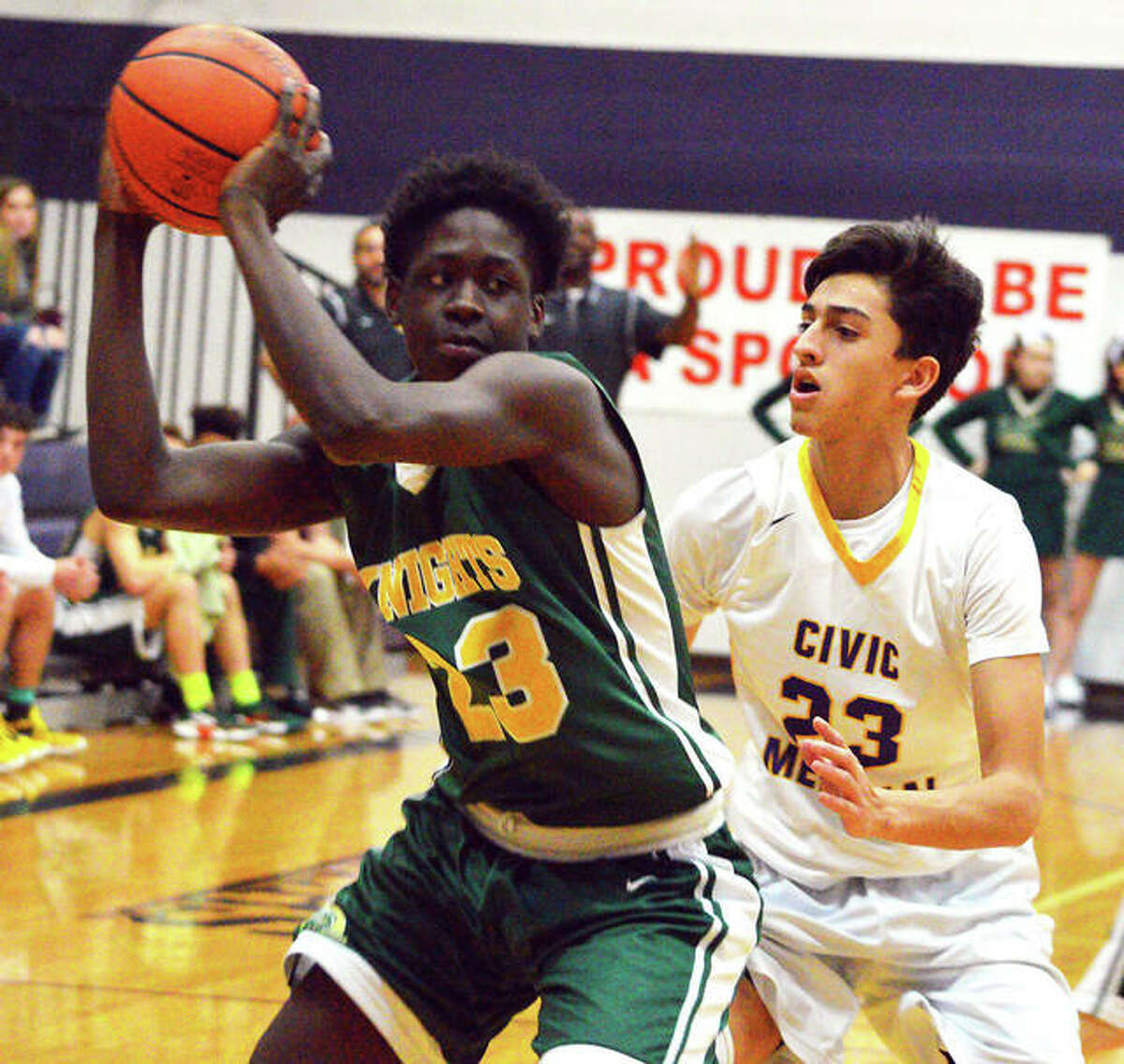 Metro-East Lutheran freshman DeMarcus Bean (left) looks to pass the ball while being guarded by Civic Memorial's Travis Hilligoss during the first quarter of Thursday's fifth-place semifinal in the Rick McGraw Memorial Invitational at Litchfield High School.