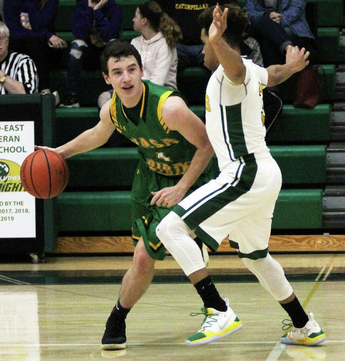 Southwestern's Johnathan Watson (left), shown in a game earlier this season at Metro-East Lutheran in Edwardsville, had eight points and 12 rebounds Thursday night in the Piasa Birds win over Staunton at the Macoupin County Tourney in Mount Olive.