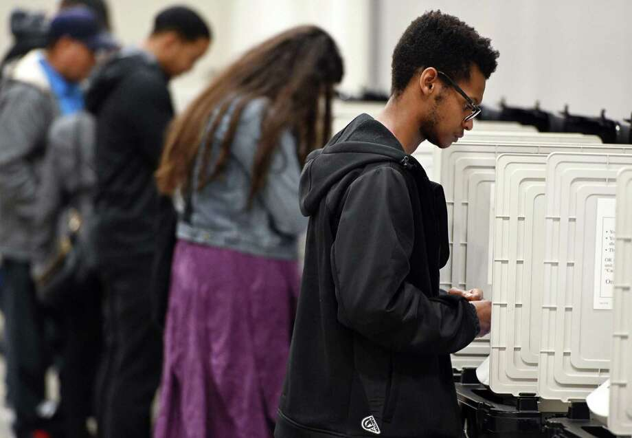 In this 2018 file photo, people cast their ballots ahead of the Nov. 6, general election at Jim Miller Park in Marietta, Ga. Photo: Associated Press / Copyright 2018 The Associated Press. All rights reserved.