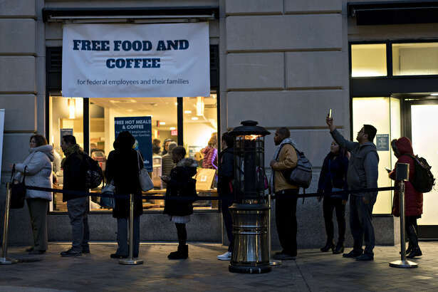 Customers wait in line outside a restaurant opened for federal workers and their families during a partial government shutdown in Washington D.C. on Jan. 17, 2019.