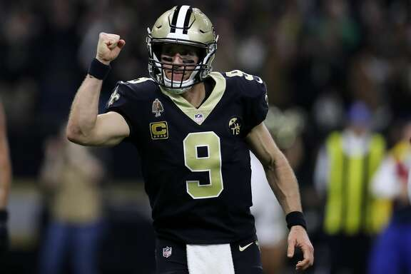 NEW ORLEANS, LOUISIANA - JANUARY 13: Drew Brees #9 of the New Orleans Saints reacts after a touchdown during the NFC Divisional Playoff at the Mercedes Benz Superdome on January 13, 2019 in New Orleans, Louisiana. (Photo by Chris Graythen/Getty Images)